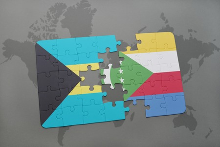 puzzle with the national flag of bahamas and comoros on a world map background. 3D illustration Stock Photo