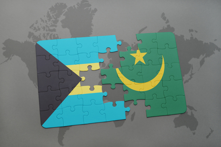 puzzle with the national flag of bahamas and mauritania on a world map background. 3D illustration Stock Photo