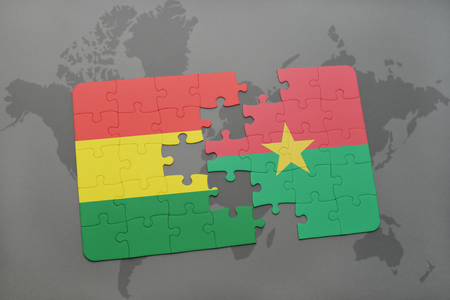 puzzle with the national flag of bolivia and burkina faso on a world map background. 3D illustration Banco de Imagens