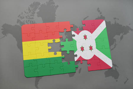 puzzle with the national flag of bolivia and burundi on a world map background. 3D illustration Banco de Imagens