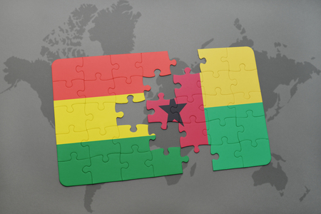 puzzle with the national flag of bolivia and guinea bissau on a world map background. 3D illustration