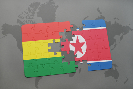 puzzle with the national flag of bolivia and north korea on a world map background. 3D illustration