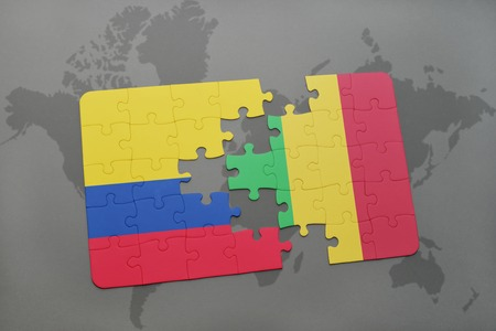 puzzle with the national flag of colombia and mali on a world map background. 3D illustration Stock Photo
