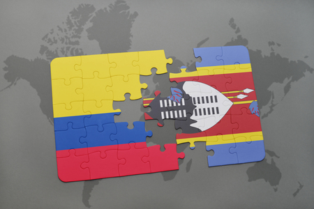 puzzle with the national flag of colombia and swaziland on a world map background. 3D illustration Stock Photo