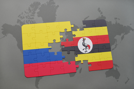 colombian: puzzle with the national flag of colombia and uganda on a world map background. 3D illustration Stock Photo