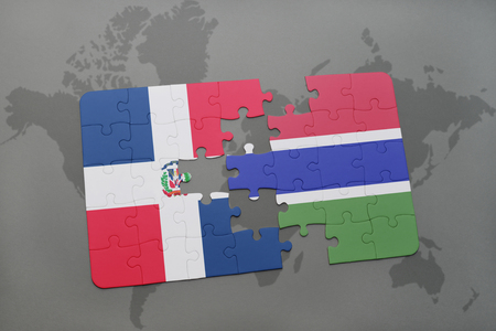 puzzle with the national flag of dominican republic and gambia on a world map background. 3D illustration
