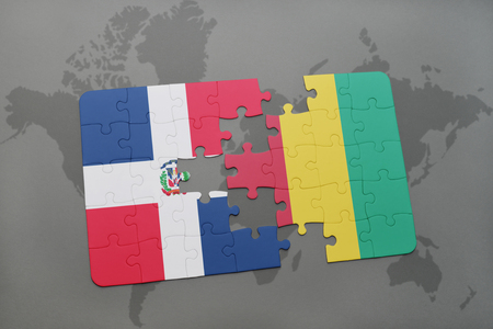puzzle with the national flag of dominican republic and guinea on a world map background. 3D illustration Stock Photo