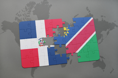 puzzle with the national flag of dominican republic and namibia on a world map background. 3D illustration