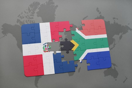 puzzle with the national flag of dominican republic and south africa on a world map background. 3D illustration Stock Photo