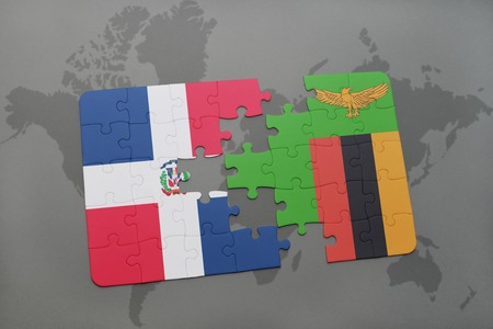 dominican: puzzle with the national flag of dominican republic and zambia on a world map background. 3D illustration Stock Photo