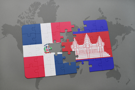 dominican: puzzle with the national flag of dominican republic and cambodia on a world map background. 3D illustration