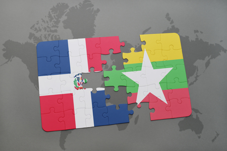 puzzle with the national flag of dominican republic and myanmar on a world map background. 3D illustration