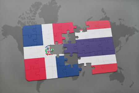 dominican: puzzle with the national flag of dominican republic and thailand on a world map background. 3D illustration Stock Photo