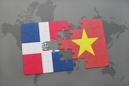 puzzle with the national flag of dominican republic and vietnam on a world map background. 3D illustration