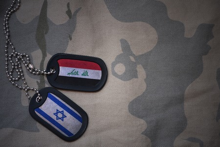 iraqi: army blank, dog tag with flag of iraq and israel on the khaki texture background. military concept