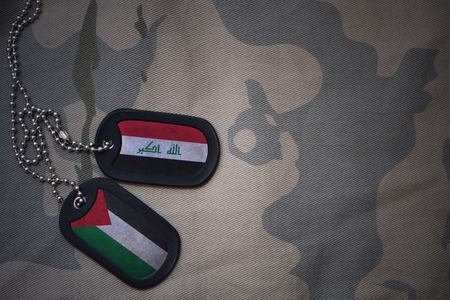 army blank, dog tag with flag of iraq and palestine on the khaki texture background. military concept