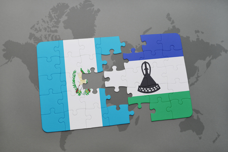 lesotho: puzzle with the national flag of guatemala and lesotho on a world map background. 3D illustration