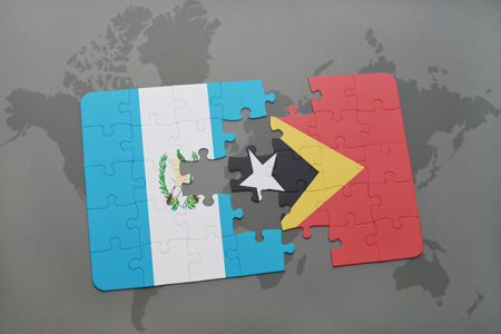 timor: puzzle with the national flag of guatemala and east timor on a world map background. 3D illustration