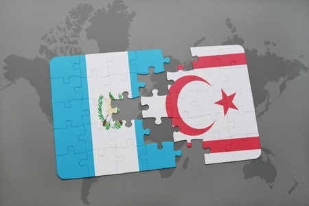 puzzle with the national flag of guatemala and northern cyprus on a world map background. 3D illustration