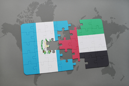 puzzle with the national flag of guatemala and united arab emirates on a world map background. 3D illustration