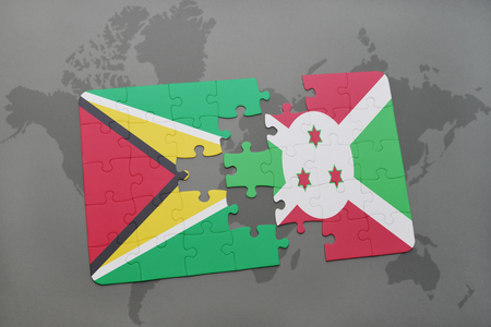 puzzle with the national flag of guyana and burundi on a world map background. 3D illustration