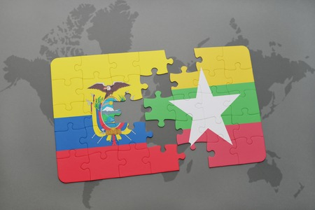 puzzle with the national flag of ecuador and myanmar on a world map background. 3D illustration Stock Photo