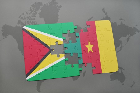 puzzle with the national flag of guyana and cameroon on a world map background. 3D illustration Stock Photo