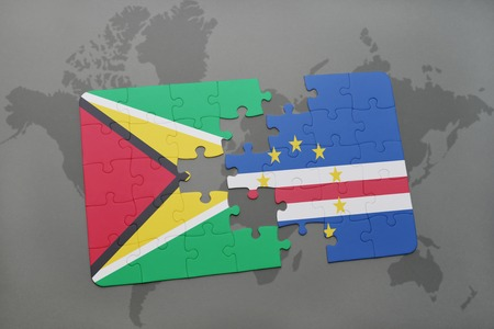 praia: puzzle with the national flag of guyana and cape verde on a world map background. 3D illustration Stock Photo