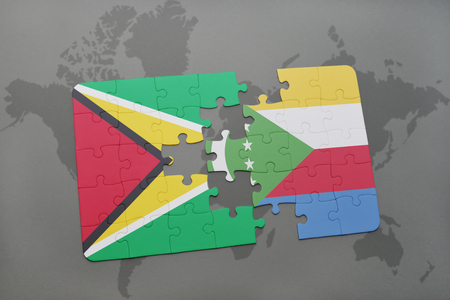 guyanese: puzzle with the national flag of guyana and comoros on a world map background. 3D illustration Stock Photo