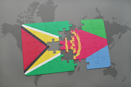 puzzle with the national flag of guyana and eritrea on a world map background. 3D illustration Stock Photo