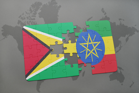 guyanese: puzzle with the national flag of guyana and ethiopia on a world map background. 3D illustration Stock Photo