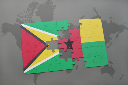 guyanese: puzzle with the national flag of guyana and guinea bissau on a world map background. 3D illustration