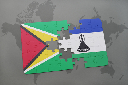 guyanese: puzzle with the national flag of guyana and lesotho on a world map background. 3D illustration Stock Photo