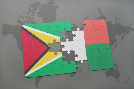 guyanese: puzzle with the national flag of guyana and madagascar on a world map background. 3D illustration