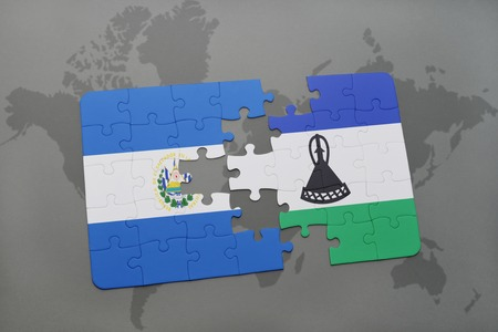puzzle with the national flag of el salvador and lesotho on a world map background. 3D illustration Stock Photo