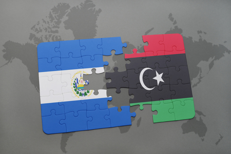 puzzle with the national flag of el salvador and libya on a world map background. 3D illustration Stock Photo