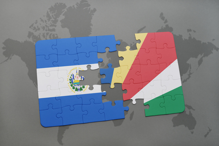puzzle with the national flag of el salvador and seychelles on a world map background. 3D illustration