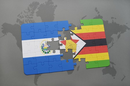 puzzle with the national flag of el salvador and zimbabwe on a world map background. 3D illustration Stock Photo