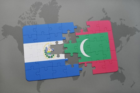 puzzle with the national flag of el salvador and maldives on a world map background. 3D illustration