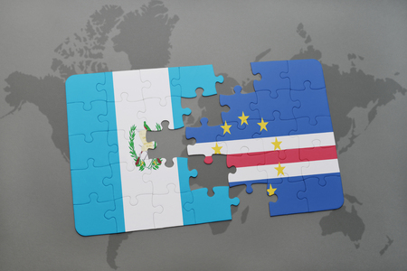 puzzle with the national flag of guatemala and cape verde on a world map background. 3D illustration
