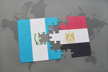 puzzle with the national flag of guatemala and egypt on a world map background. 3D illustration