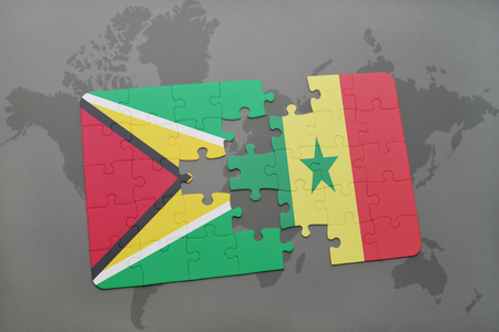 dakar: puzzle with the national flag of guyana and senegal on a world map background. 3D illustration