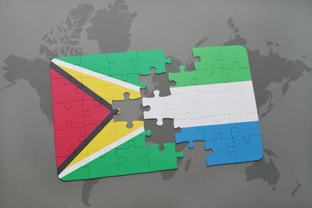 puzzle with the national flag of guyana and sierra leone on a world map background. 3D illustration Stock Photo