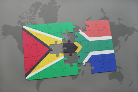 guyanese: puzzle with the national flag of guyana and south africa on a world map background. 3D illustration