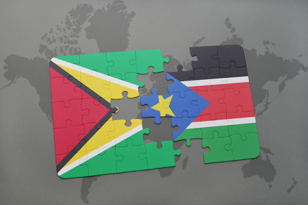 guyanese: puzzle with the national flag of guyana and south sudan on a world map background. 3D illustration