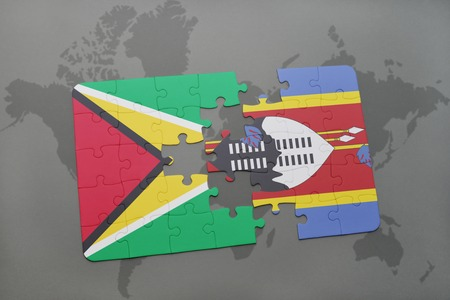 guyanese: puzzle with the national flag of guyana and swaziland on a world map background. 3D illustration