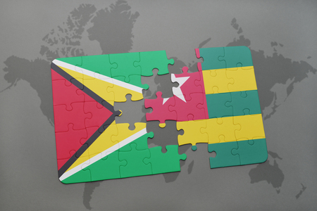 guyanese: puzzle with the national flag of guyana and togo on a world map background. 3D illustration