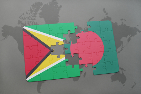 guyanese: puzzle with the national flag of guyana and bangladesh on a world map background. 3D illustration Stock Photo