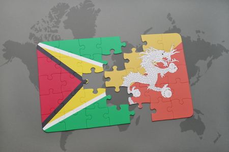 puzzle with the national flag of guyana and bhutan on a world map background. 3D illustration Stock Photo