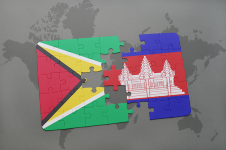 guyanese: puzzle with the national flag of guyana and cambodia on a world map background. 3D illustration